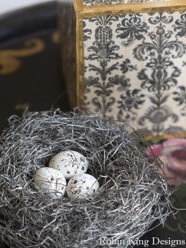 Ivory and Black Speckled Eggs in Bird Nest
